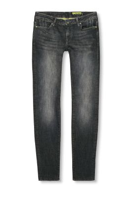 Jeans with unfinished leg hems